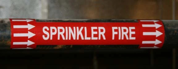 image of a red sprinkler fire pipe marking label
